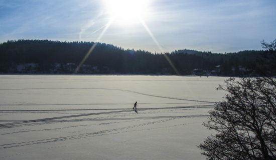 cross-country-skier-on-lake